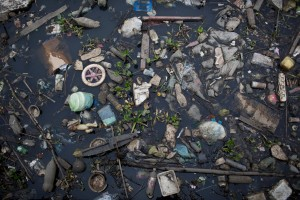 In this Oct. 23, 2013 photo, trash floats on the polluted waters of Guababara Bay in Rio de Janeiro, Brazil. Rio de Janeiro will host the 2016 Olympic Games. Olympic sailors gathered at Guanabara Bay to compete in an event on Saturday, Dec. 7, 2013. Rio's local Olympic organizing committee has promised the pollution will be cleaned up when the Olympics open in 2106, and government officials have pledged to reduce the pollution flowing into the bay. (AP Photo/Felipe Dana)